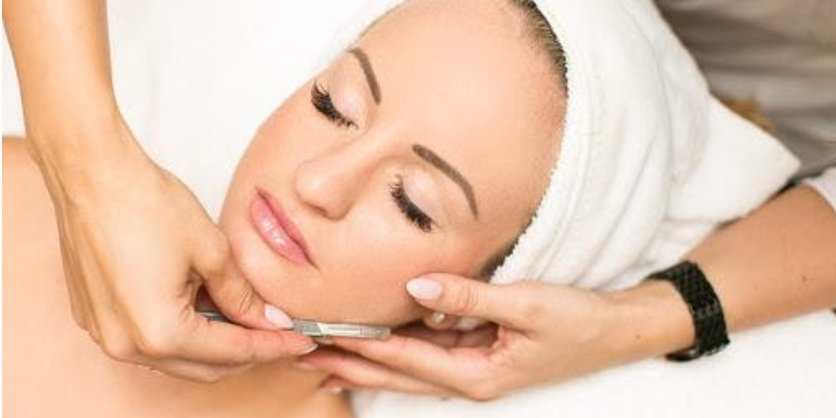 aesthetician performing dermaplaning