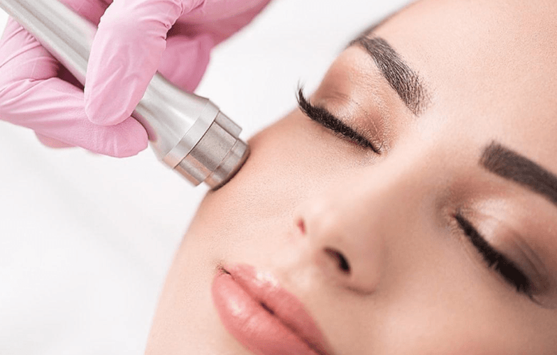 aesthetician performing microdermabrasion