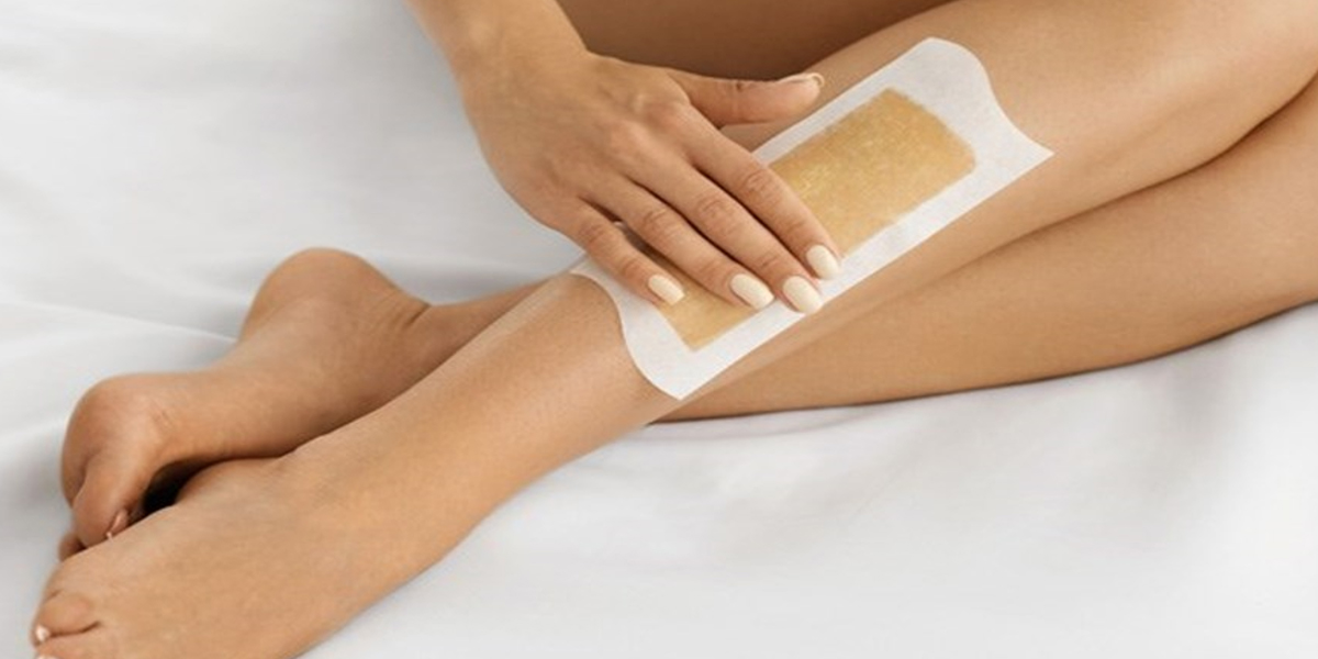 aesthetician applying sugaring paste